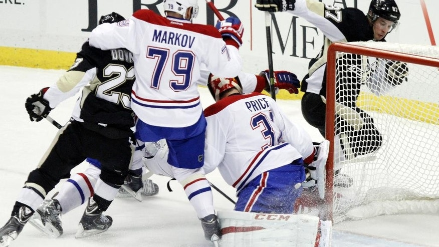 Montreal Canadiens goalie Carey Price (31) stops a shot by Pittsburgh Penguins' Sidney Crosby (87) during the first period of an NHL hockey game in Pittsburgh, Saturday, Jan. 3, 2015. (AP Photo/Tom E. Puskar)