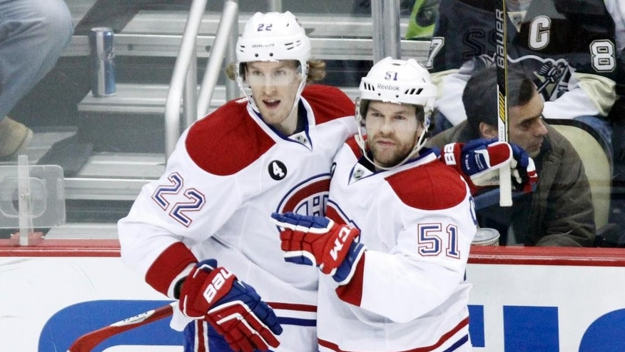 Montreal Canadiens' David Desharnais (51) is congratulated by Dale Weise (22) after scoring a goal against the Pittsburgh Penguins during the first period of an NHL hockey game in Pittsburgh, Saturday, Jan. 3, 2015. (AP Photo/Tom E. Puskar)