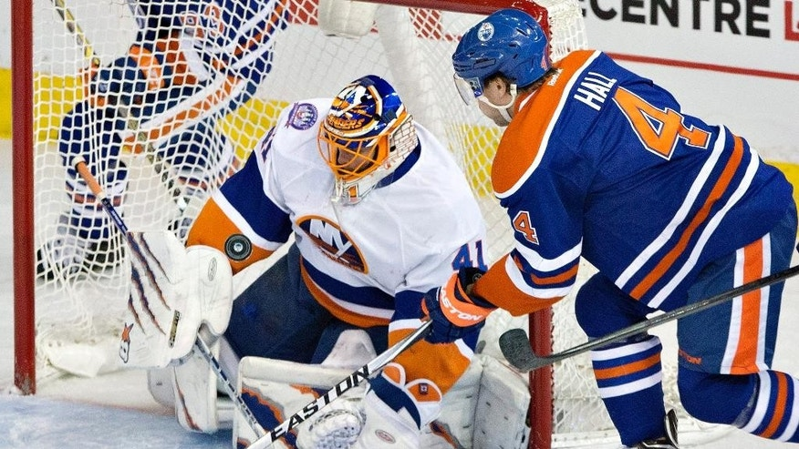 New York Islanders Jaroslav Halak (41) makes a save on Edmonton Oilers Taylor Hall (4) during the second period of an NHL hockey game, Sunday, Jan. 4, 2015 in Edmonton, Alberta. (AP Photo/The Canadian Press, Jason Franson)