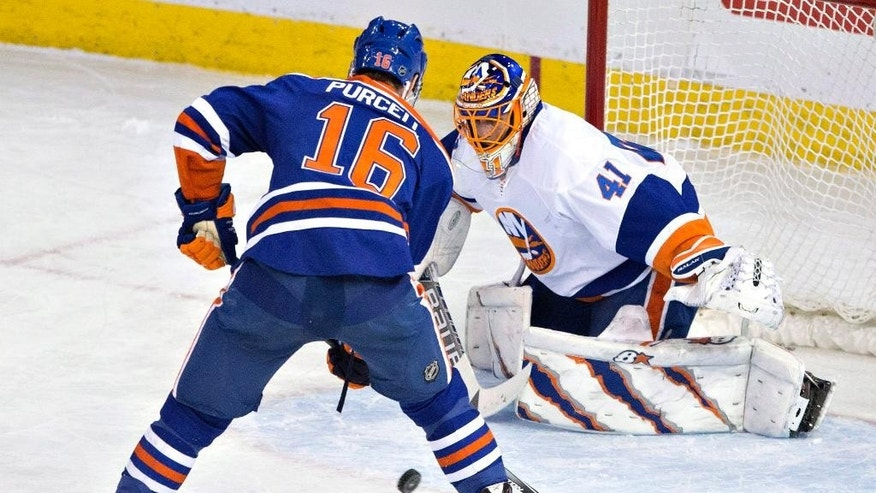 New York Islanders Jaroslav Halak (41) makes the save on Edmonton Oilers Teddy Purcell (16) during the second period of an NHL hockey game, Sunday, Jan. 4, 2015 in Edmonton, Alberta. (AP Photo/The Canadian Press, Jason Franson)