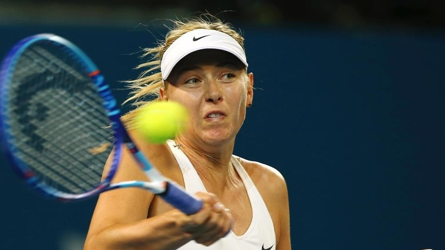 Maria Sharapova of Russia plays a shot in her match against Yaroslava Shvedova of Kazakhstan during the Brisbane International tennis tournament in Brisbane, Australia, Tuesday, Jan. 6, 2015. (AP Photo/Tertius Pickard)