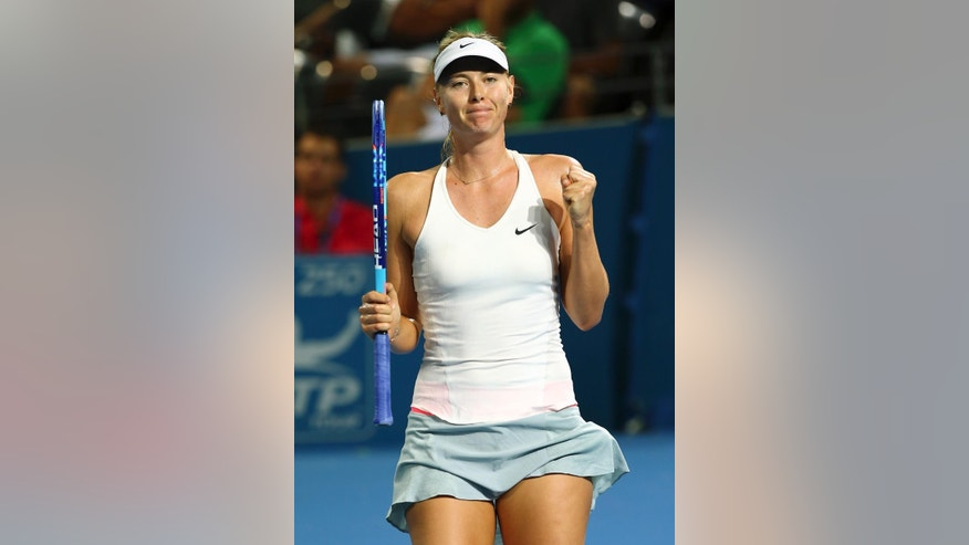 Maria Sharapova of Russia reacts after winning her match against Yaroslava Shvedova of Kazakhstan during the Brisbane International tennis tournament in Brisbane, Australia, Tuesday, Jan. 6, 2015. (AP Photo/Tertius Pickard)