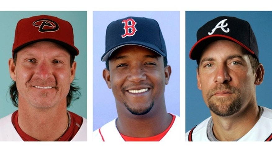 FILE - From left are Arizona Diamondbacks' Randy Johnson in 2008, Boston Red Sox' Pedro Martinez in 2003 and Atlanta Braves' John Smoltz in 2008. Randy Johnson, Pedro Martinez and John Smoltz are the leading newcomers on baseball's Hall of Fame ballot when voting is announced Tuesday, Jan. 6, 2014. (AP Photo/File)