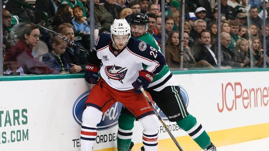 Columbus Blue Jackets defenseman Cody Goloubef (29) and Dallas Stars center Vernon Fiddler (38) compete for control of a loose puck in the first period of an NHL hockey game, Tuesday, Jan. 6, 2015, in Dallas. (AP Photo/Tony Gutierrez)