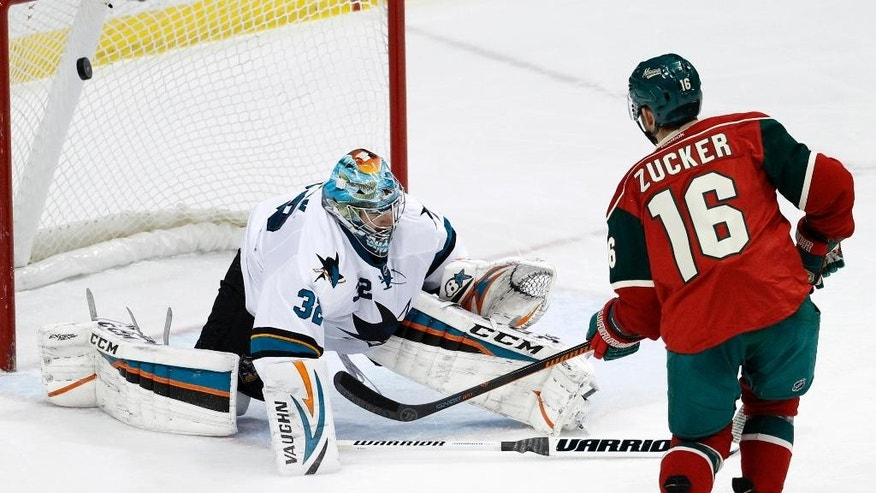 Minnesota Wild left wing Jason Zucker (16) scores on San Jose Sharks goalie Alex Stalock (32) during the first period of an NHL hockey game in St. Paul, Minn., Tuesday, Jan. 6, 2015. (AP Photo/Ann Heisenfelt)