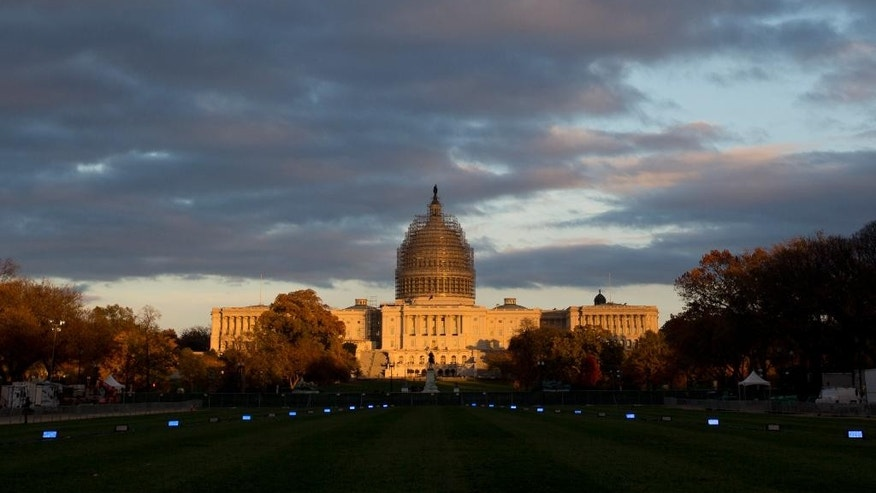 FILE - This Nov. 11, 2014, file photo shows the U.S. Capitol Building illuminated by the setting sun on the National Mall in Washington. When the leaders of the U.S. Olympic Committee meet Thursday, Jan. 8, 2015, they'll be deciding on more than a city to put in the running to host the 2024 Summer Games. They'll be picking a partner that will help shape their near- and long-term future.  Leaders from Boston, Los Angeles, San Francisco and Washington made their presentations last month and will not be present while the 15 USOC board members debate the pros and cons of each offering at their meeting at Denver International Airport. (AP Photo/Carolyn Kaster, File)