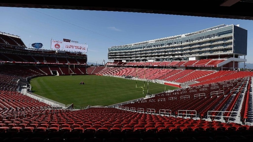 FILE - In this July 17, 2014 file photo, a groundskeeper drives across the field before the ribbon-cutting and opening of Levi's Stadium in Santa Clara, Calif. When the leaders of the U.S. Olympic Committee meet Thursday, Jan. 8, 2015, they'll be deciding on more than a city to put in the running to host the 2024 Summer Games. Leaders from Boston, Los Angeles, San Francisco and Washington made their presentations last month and will not be present while the 15 USOC board members debate the pros and cons of each offering at their meeting at Denver International Airport. (AP Photo/Eric Risberg, file)