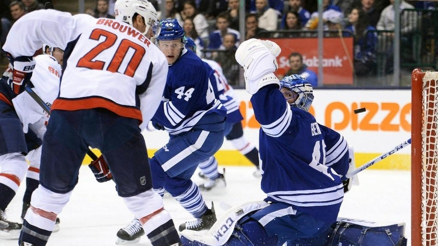 Washington Capitals forward Troy Brouwer (20) watches as the puck goes past Toronto Maple Leafs goalie Jonathan Bernier (45) during the first period of an NHL hockey game, Wednesday, Jan. 7, 2015 in Toronto. (AP Photo/The Canadian Press, Nathan Denette)