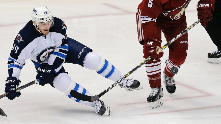 Arizona Coyotes defenseman Connor Murphy (5) checks Winnipeg Jets center Bryan Little (18) in the second period during an NHL hockey game, Thursday, Jan. 8, 2015, in Glendale, Ariz. (AP Photo/Rick Scuteri)