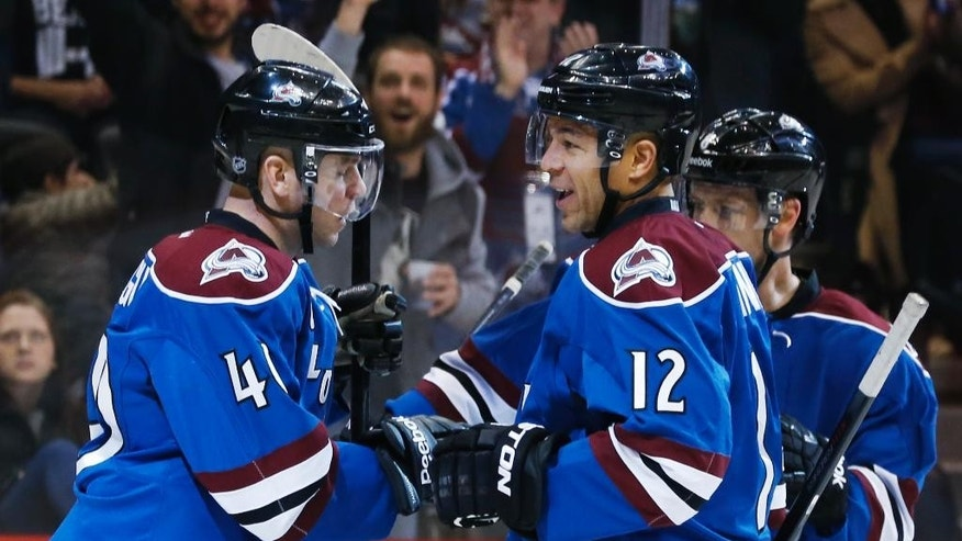 Colorado Avalanche right wing Jarome Iginla, center, celebrates his goal with left wing Alex Tanguay, left, and defenseman jan Hejda, of the Czech Republic, against the Ottawa Senators during the first period of an NHL hockey game Thursday, Jan. 8, 2015, in Denver. (AP Photo/David Zalubowski)