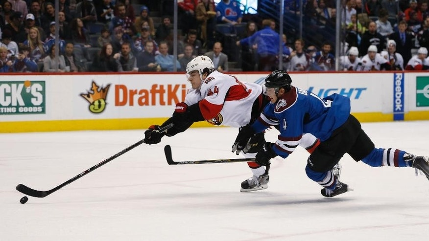 Ottawa Senators center Jean-Gabriel Pageau, left, is tripped as he drives for a shot, by Colorado Avalanche defenseman Tyson Barrie during the second period of an NHL hockey game Thursday, Jan. 8, 2015, in Denver. (AP Photo/David Zalubowski)