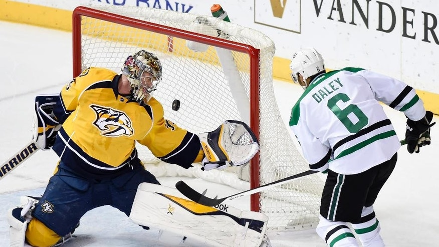 With under two seconds left in the period Dallas Stars defenseman Trevor Daley (6) shoots past Nashville Predators goalie Pekka Rinne (35), of Finland, in the second period of an NHL hockey game Thursday, Jan. 8, 2015, in Nashville, Tenn. The goal tied the game 2-2. (AP Photo/Sanford Myers)