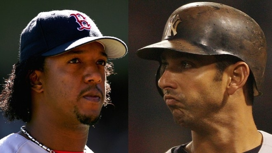 Left: Pedro Martinez of the Boston Red Sox during their game against the New York Yankees on September 19, 2004 at Yankee Stadium in the Bronx, New York.  (Photo by Ezra Shaw/Getty Images) Right: Jorge Posada of the New York Yankees on April 12, 2008 at Fenway Park in Boston, Massachusetts. (Photo by Elsa/Getty Images)