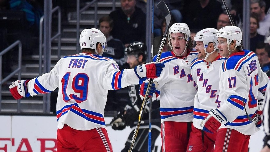 New York Rangers defenseman Kevin Klein, second from right, celebrates his goal with teammates right wing Jesper Fast, left, of Sweden, right wing Kevin Hayes, center, and defenseman John Moore, right, as Los Angeles Kings center Jarret Stoll skates in the background during the second period of an NHL hockey game, Thursday, Jan. 8, 2015, in Los Angeles. (AP Photo/Mark J. Terrill)