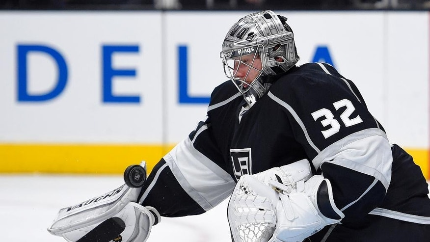 Los Angeles Kings goalie Jonathan Quick stops a shot during the first period of an NHL hockey game against the New York Rangers, Thursday, Jan. 8, 2015, in Los Angeles. (AP Photo/Mark J. Terrill)
