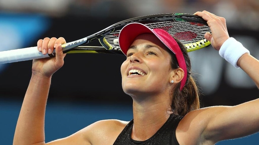 Ana Ivanovic of Serbia celebrates after she won her semifinal match against Varvara Lepchenko of the USA 7-6, 6-4 during the Brisbane International tennis tournament in Brisbane, Australia, Friday, Jan. 9, 2015. (AP Photo/Tertius Pickard)
