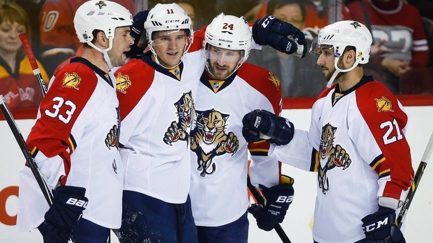 Florida Panthers' Brad Boyes, second from right, celebrates his goal with teammates, from left, Willie Mitchell, Jonathan Huberdeau and Vincent Trocheck during the first period of an NHL hockey game against the Calgary Flames on Friday, Jan. 9, 2015, in Calgary, Alberta. (AP Photo/The Canadian Press, Jeff McIntosh)