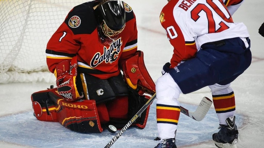Florida Panthers' Sean Bergenheim, right, from Finland, scores on Calgary Flames goalie Jonas Hiller, from Switzerland, during the second period of an NHL hockey game Friday, Jan. 9, 2015, in Calgary, Alberta. (AP Photo/The Canadian Press, Jeff McIntosh)