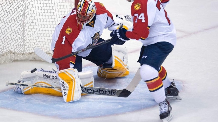 Florida Panthers defenseman Shane O'Brien (74) watches teammate Roberto Luongo makes a save during first-period NHL hockey game action against the Vancouver Canucks in Vancouver, British Columbia, Thursday, Jan. 8, 2015. (AP Photo/The Canadian Press, Jonathan Hayward)