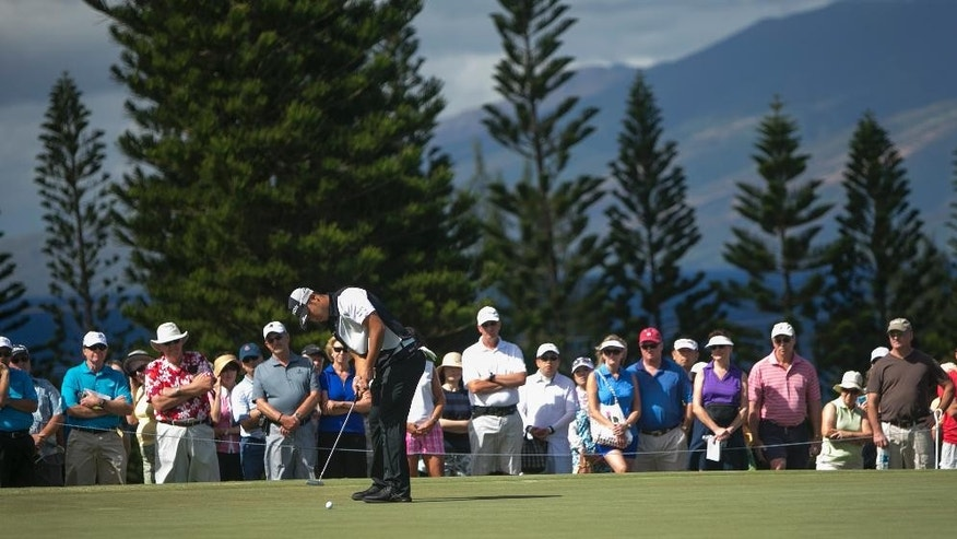 Hideki Matsuyama, of Japan, putts on the second green during the first round of the Tournament of Champions golf tournament, Friday, Jan. 9, 2015, in Kapalua, Hawaii. (AP Photo/Marco Garcia)