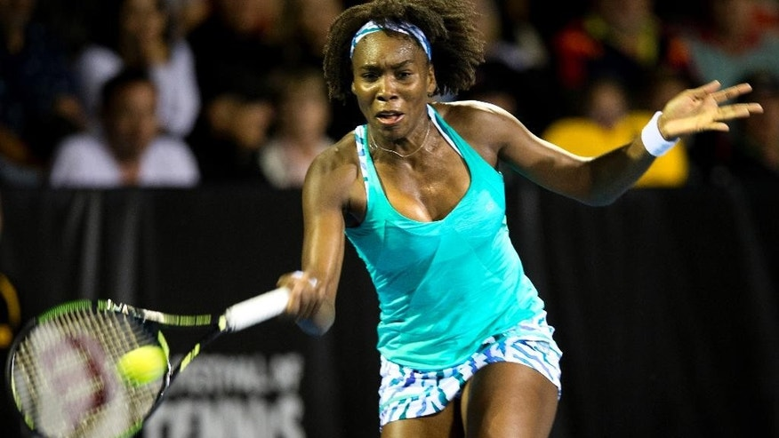 Venus Williams of the U.S. plays a forehand shot in her Semi-final match against her compatriot  Lauren Davis during the ASB Classic tennis tournament in Auckland, New Zealand, Friday Jan. 9 2015. (AP Photo/New Zealand Herald, Nick Reed) AUSTRALIA OUT, NEW ZEALAND OUT