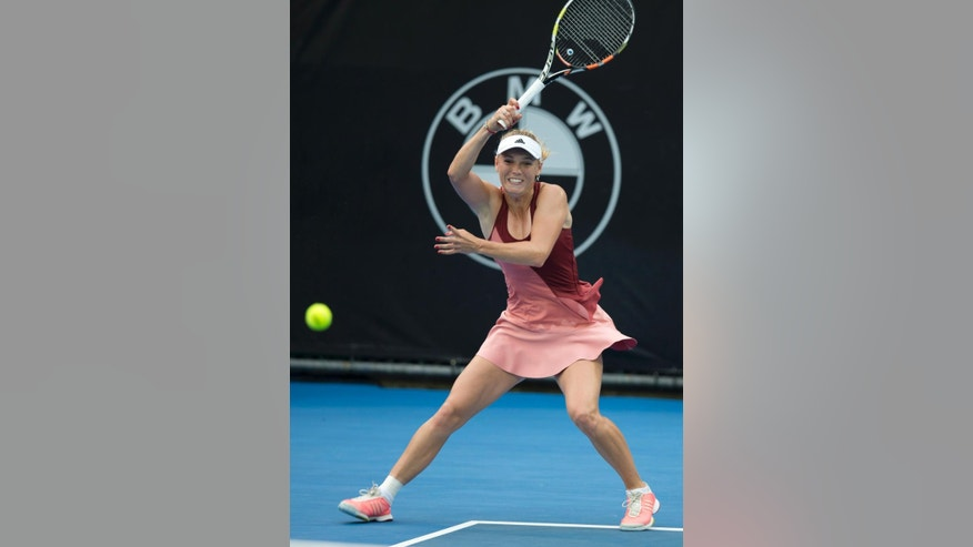 Caroline Wozniacki plays a backhand shot in a semi-final match against Barbora Zahlavova Strycova of the Czech Republic during the ASB Classic tennis tournament in Auckland, New Zealand, Friday Jan. 9 2015. (AP Photo/New Zealand Herald, Nick Reed) AUSTRALIA OUT, NEW ZEALAND OUT