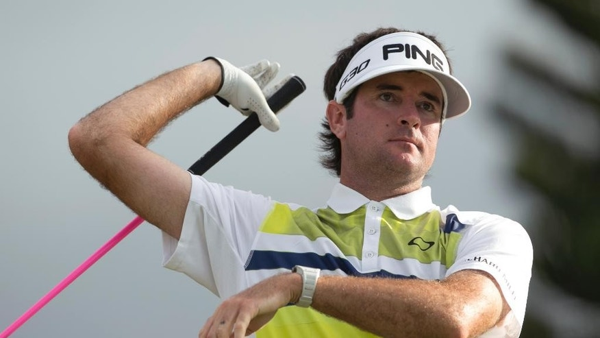 Bubba Watson reacts after taking a provisional shot on the 18th tee during the first round of the Tournament of Champions golf tournament, Friday, Jan. 9, 2015, in Kapalua, Hawaii. (AP Photo/Marco Garcia)