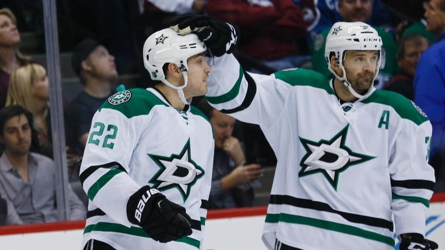 Dallas Stars center Vernon Fiddler, right, congratulates center Colton Sceviour after his goal against the Colorado Avalanche in the first period of an NHL hockey game Saturday, Jan. 10, 2015, in Denver. (AP Photo/David Zalubowski)