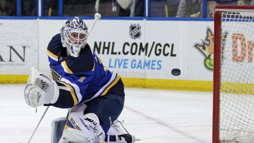 St. Louis Blues goalie Brian Elliott (1) watches a shot from Carolina Hurricanes' Jeff Skinner (53) sail past him into the net in the first period of an NHL hockey game, Saturday, Jan. 10, 2015 in St. Louis. Elliot was replaced in goal by teammate  goalie Jake Allen after giving up three goals in the first period.(AP Photo/Tom Gannam)