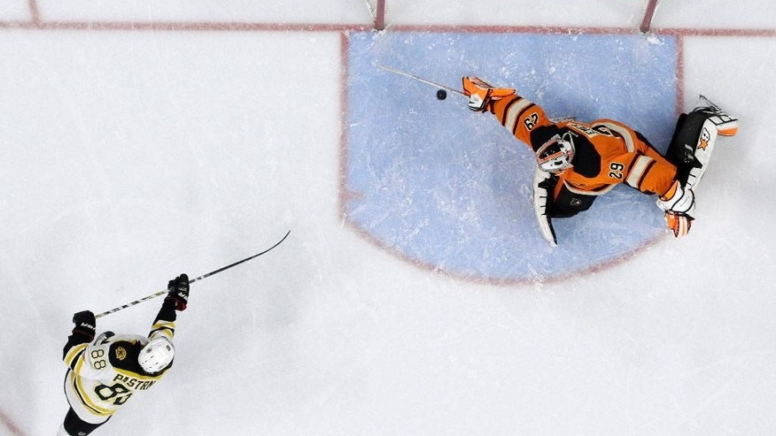 Boston Bruins' David Pastrnak, left, of the Czech Republic, scores a goal past Philadelphia Flyers' Ray Emery during the third period of an NHL hockey game, Saturday, Jan. 10, 2015, in Philadelphia. Boston won 3-1. (AP Photo/Matt Slocum)