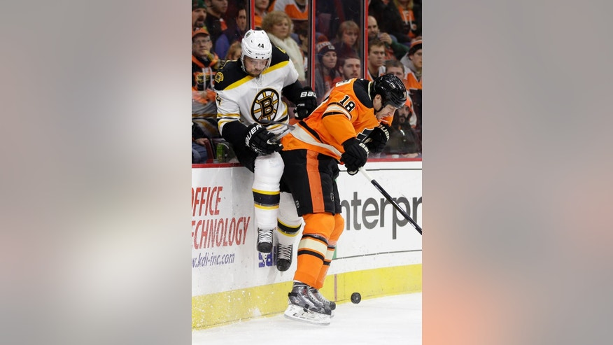Boston Bruins' Dennis Seidenberg (44), of Germany, collides with Philadelphia Flyers' R.J. Umberger (18) during the second period of an NHL hockey game, Saturday, Jan. 10, 2015, in Philadelphia. (AP Photo/Matt Slocum)