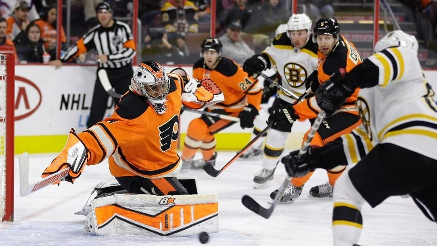 Boston Bruins' David Pastrnak, right, of the Czech Republic, scores a goal past Philadelphia Flyers' Ray Emery, left, during the third period of an NHL hockey game, Saturday, Jan. 10, 2015, in Philadelphia. Boston won 3-1. (AP Photo/Matt Slocum)