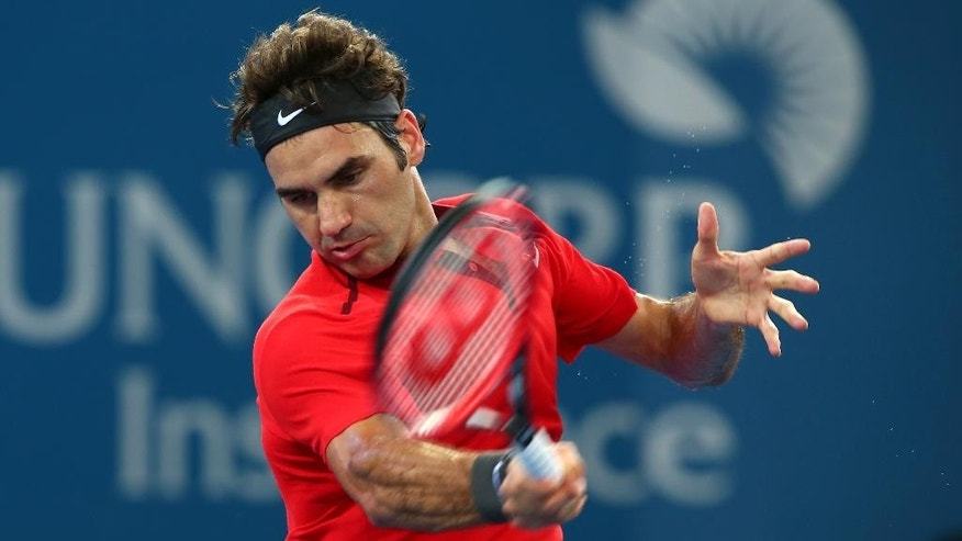 Roger Federer of Switzerland plays a shot in his semifinal match against Grigor Dimitrov of Bulgaria during the Brisbane International tennis tournament in Brisbane, Australia, Saturday, Jan. 10, 2015. (AP Photo/Tertius Pickard)