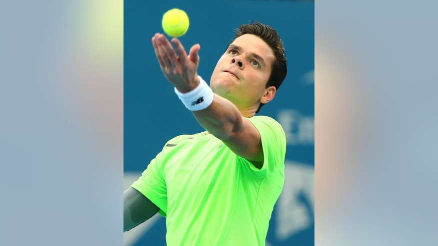 Milos Raonic of Canada prepares to serve in his semifinal match against Kei Nishikori of Japan during the Brisbane International tennis tournament in Brisbane, Australia, Saturday, Jan. 10, 2015. (AP Photo/Tertius Pickard)