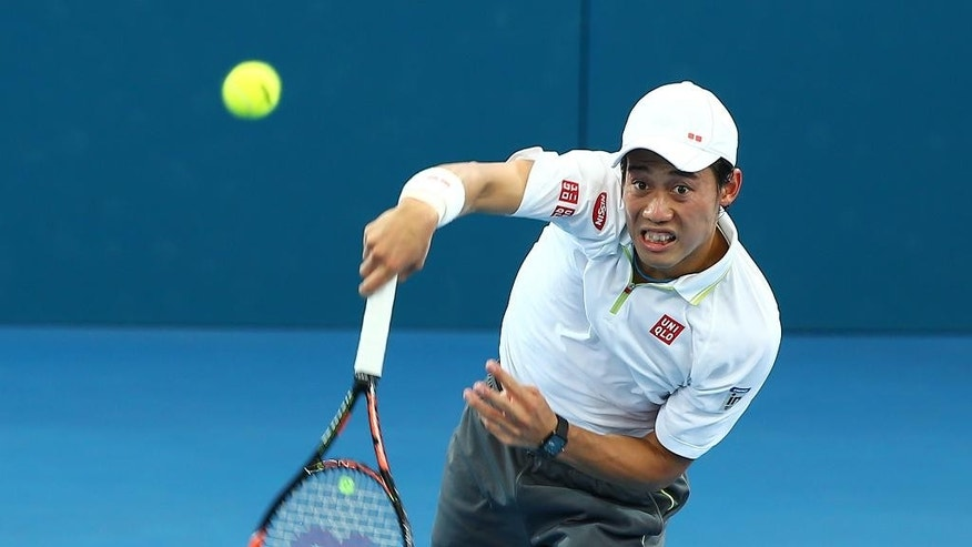 Kei Nishikori of Japan serves in his semifinal match against Milos Raonic of Canada during the Brisbane International tennis tournament in Brisbane, Australia, Saturday, Jan. 10, 2015. (AP Photo/Tertius Pickard)