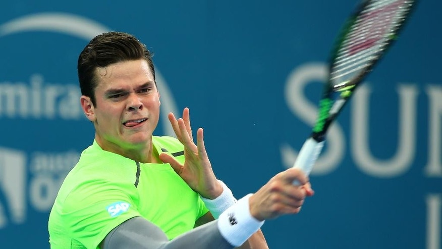 Milos Raonic of Canada plays a shot in his semifinal match against Kei Nishikori of Japan during the Brisbane International tennis tournament in Brisbane, Australia, Saturday, Jan. 10, 2015. (AP Photo/Tertius Pickard)