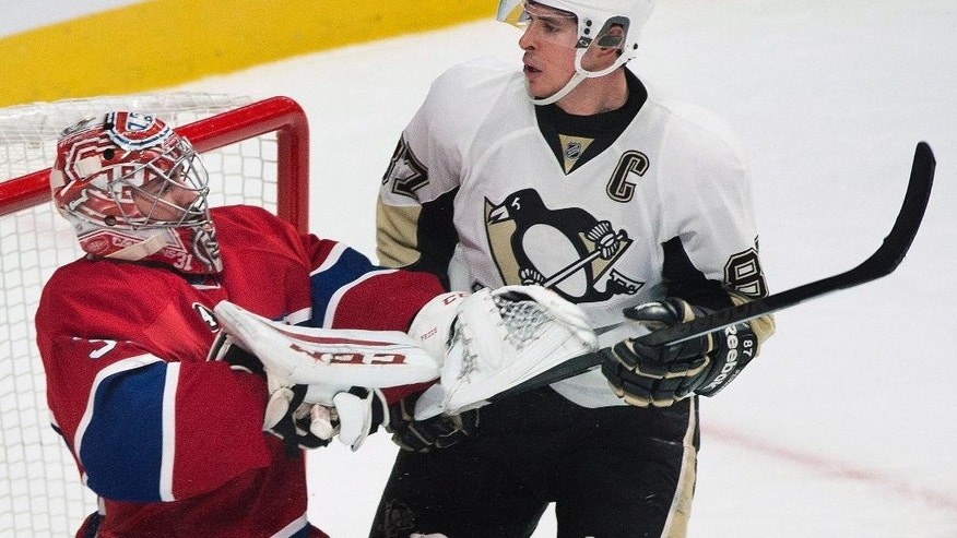 Pittsburgh Penguins' Sidney Crosby (87) moves in on Montreal Canadiens goaltender Carey Price during the second period of an NHL hockey game Saturday, Jan. 10, 2015, in Montreal. (AP Photo/The Canadian Press, Graham Hughes)