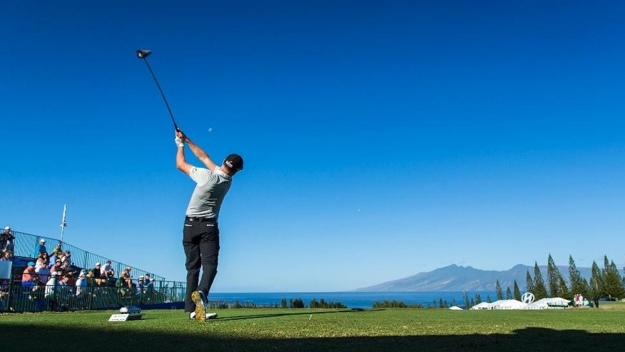 Nick Taylor, of Canada, hits off the first tee during the second round of the Tournament of Champions golf tournament, Saturday, Jan. 10, 2015, in Kapalua, Hawaii.  (AP Photo/Marco Garcia)