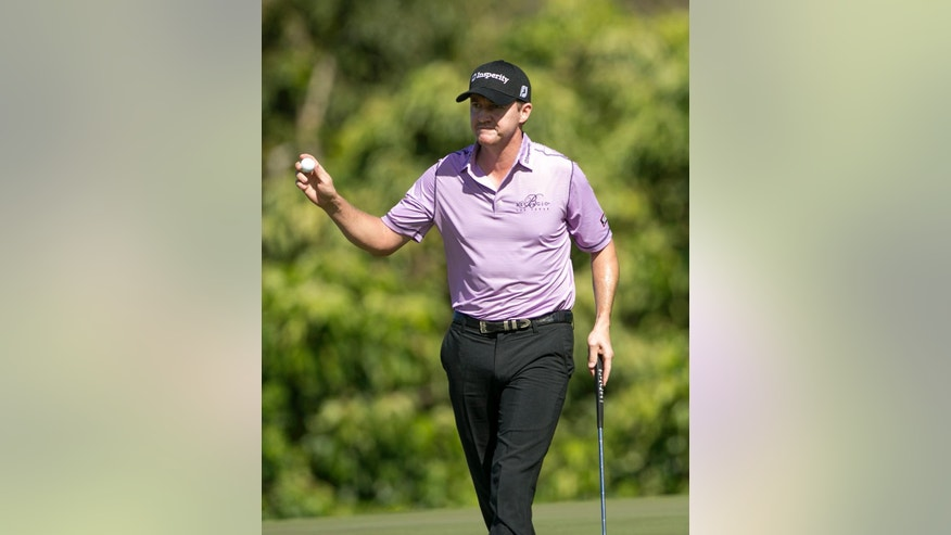 Jimmy Walker waves to the gallery on the 15th green during the second round of the Tournament of Champions golf tournament, Saturday, Jan. 10, 2015, in Kapalua, Hawaii.  (AP Photo/Marco Garcia)