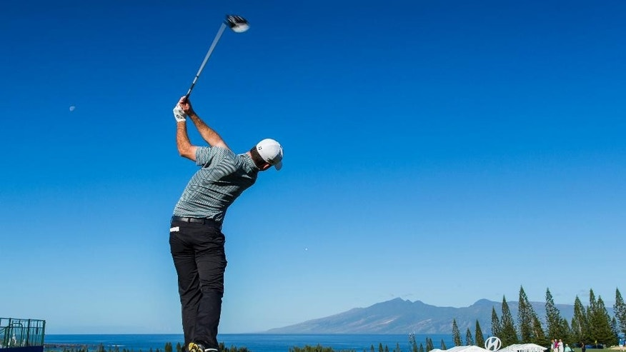 Zach Johnson hits off the first tee during the second round of the Tournament of Champions golf tournament, Saturday, Jan. 10, 2015, in Kapalua, Hawaii.  (AP Photo/Marco Garcia)