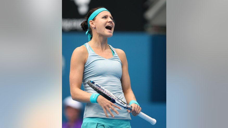 Lucie Safarova of the Czech Republic yells out after missing a shot against Australia's Samantha Stosur in their match at the Sydney International tennis tournament in Sydney Monday, Jan. 12, 2015. Stosur won the match 7-6, 5-7, 6-3. (AP Photo/Rick Rycroft)