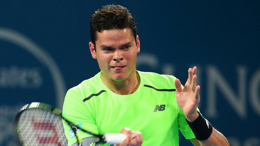 Milos Raonic of Canada plays a shot in the men's final match against Roger Federer of Switzerland during the Brisbane International tennis tournament in Brisbane, Australia, Sunday, Jan. 11, 2015. (AP Photo/Tertius Pickard)