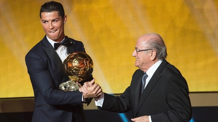 Cristiano Ronaldo congratulated by FIFA President Joseph Blatter the 2014 prize at the FIFA Ballon d'Or.