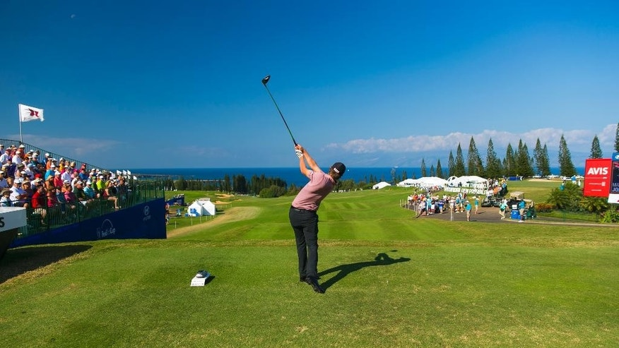 Matt Jones, of Australia, tees off on the first tee during the final round of the Tournament of Champions golf tournament Monday, Jan. 12, 2015, in Kapalua, Hawaii.  (AP Photo/Marco Garcia)