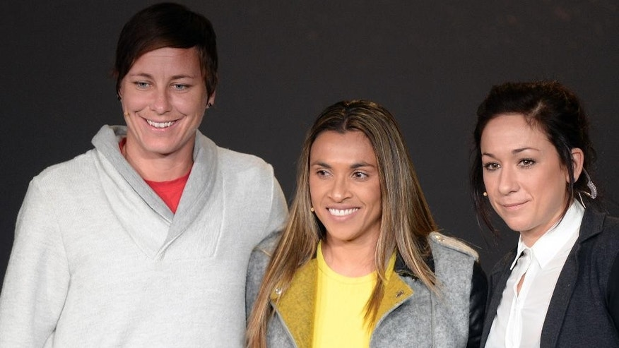 US Abby Wambach, left, Brazil's Marta, center, and Germany's  Nadine Kessler, right, nominees of the FIFA Women's World Player of the Year Award, attend a press conference prior to the FIFA Ballon d'Or awarding ceremony at the Kongresshaus in Zurich, Switzerland, Monday, Jan. 12, 2015. (AP Photo/Keystone, Walter Bieri)