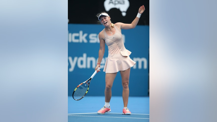 Caroline Wozniacki of Denmark reacts while playing Barbora Zahlavova Strycova of the Czech Republic during their match at the Sydney International tennis tournament in Sydney, Monday, Jan. 12, 2015. Wozniacki retired from the match with a wrist injury. (AP Photo/Rick Rycroft)