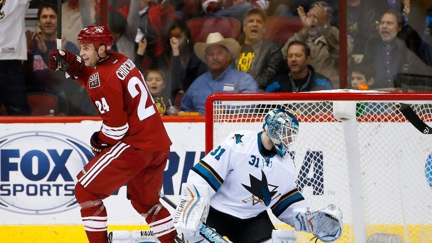 Arizona Coyotes' Kyle Chipchura (24) smiles as he celebrates a goal by teammate Mikkel Boedker against San Jose Sharks' Antti Niemi (31), of Finland, during the first period of an NHL hockey game Tuesday, Jan. 13, 2015, in Glendale, Ariz. (AP Photo/Ross D. Franklin)