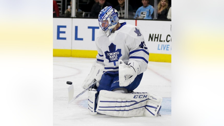 Toronto Maple Leafs goalie Jonathan Bernier blocks a shot against the Los Angeles Kings during the second period of an NHL hockey game in Los Angeles, Monday, Jan. 12, 2015. (AP Photo/Chris Carlson)