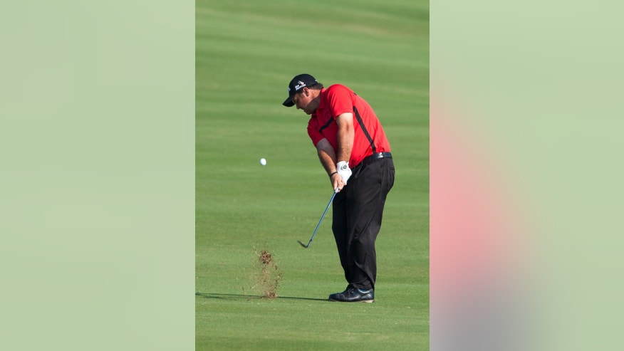 Patrick Reed hits off the fairway and onto the the 18th green during a play off round against Jimmy Walker at the Tournament of Champions golf tournament, Monday, Jan. 12, 2015, in Kapalua, Hawaii.  (AP Photo/Marco Garcia)