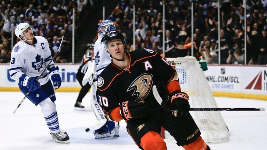 Anaheim Ducks right wing Corey Perry celebrates his goal against the Toronto Maple Leafs during the second period of an NHL hockey game in Anaheim, Calif., Wednesday, Jan. 14, 2015. (AP Photo/Chris Carlson)